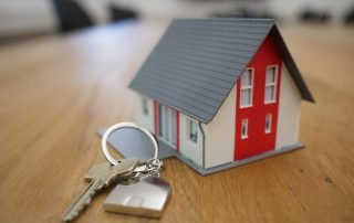 Small house on table with keys
